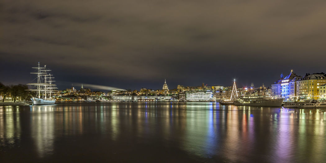 Stockholm at night. Old town to the right and Skeppsholmen to the left with Af Chapman. Building Exterior Architecture Built Structure City Water Reflection Night Sky Building Illuminated Waterfront Nature Cloud - Sky No People River Cityscape Travel Destinations Transportation Urban Skyline Outdoors Skyscraper Winter christmas tree Stockholm, Sweden Stockholm Old Town