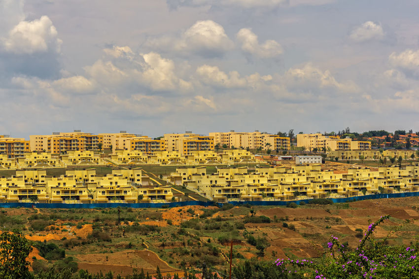 KIGALI,RWANDA - OCTOBER 19,2017: Gacuriro This is an area with new,modern and very expensive apartment buildings.It's opposite Kibaza,where mostly poor people live. Kigali Rwanda Africa Architecture Beauty In Nature Building Exterior Built Structure City Cloud - Sky Day Landscape Nature No People Outdoors Scenics Sky Travel Destinations Tree