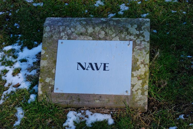 Sign Signage Start Of Spring End Of Winter Nave Religious Place Snow On Grass Stone Sign
