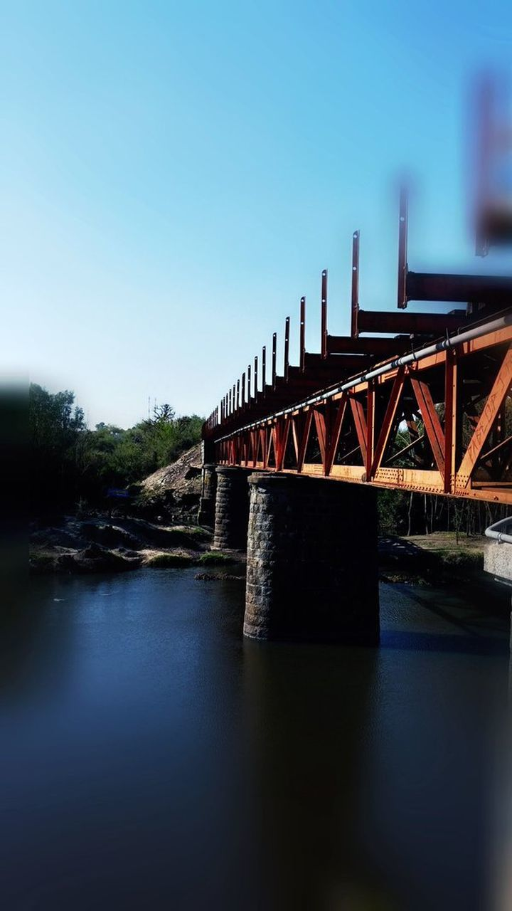 bridge - man made structure, connection, built structure, water, architecture, river, transportation, clear sky, outdoors, no people, sky, day, nature