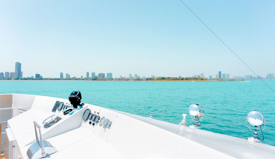 minimalistic view from the yacht The Creative - 2018 EyeEm Awards The Still Life Photographer - 2018 EyeEm Awards Travel Trip Vacations Architecture Beauty In Nature Blue Boat Building Building Exterior Built Structure City Cityscape Clear Sky Day Luxury Minimal Minimalism Mode Of Transportation Nature Nautical Vessel Ocean Outdoors Passenger Craft Real People River Sea Sky Skyscraper Still Life Sunlight Transportation Water Yacht