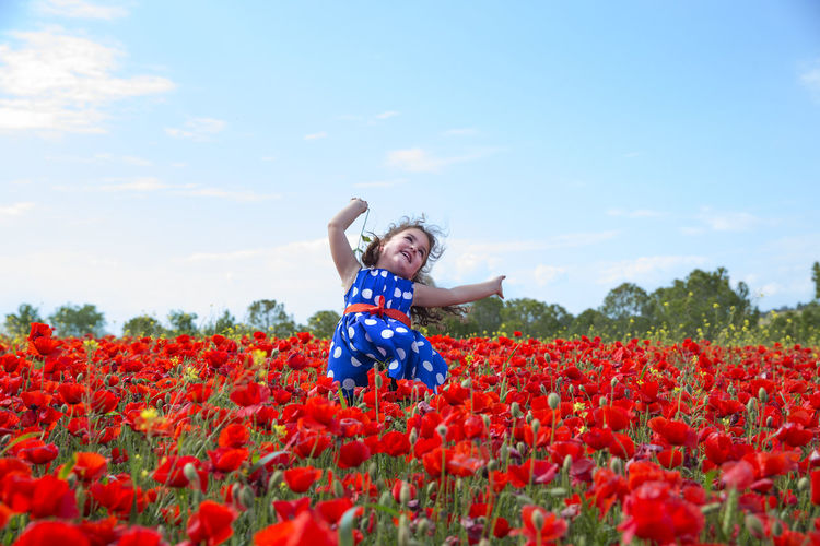 View Of Girl In Poppy Field