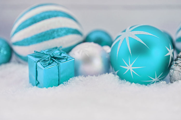 close-up of christmas decorations Background Ball Bauble Blue Box - Container Card Celebration Celebration Event Christmas Christmas Ball Christmas Card Christmas Decoration Christmas Ornament Christmas Time Christmassy Close-up Decoration Design Event Festive Gift Green Color Greeting Holiday Holiday - Event Indoors  Merry No People Ornament Present Seasonal Selective Focus Snow Still Life Studio Shot Turquoise Colored White Winter Wintry