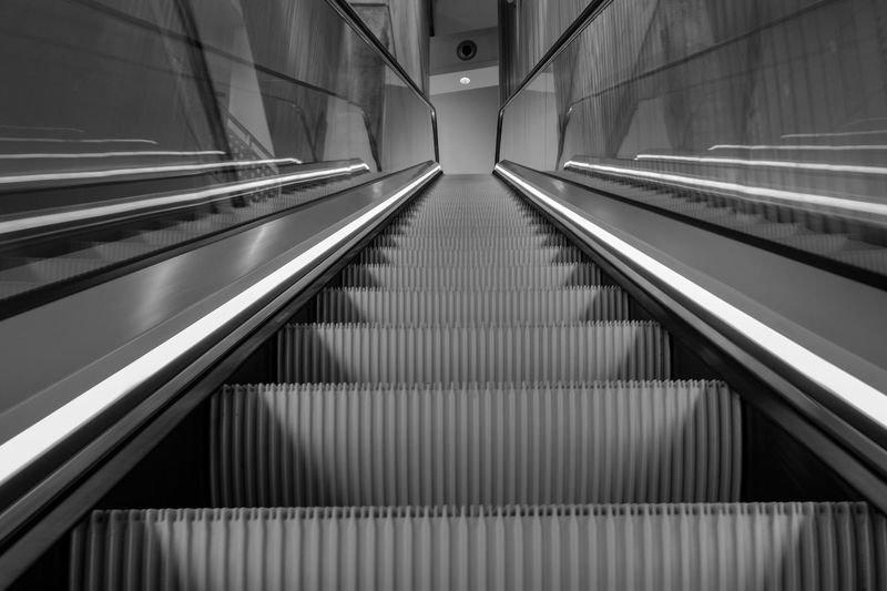 Low angle view of empty escalator in building