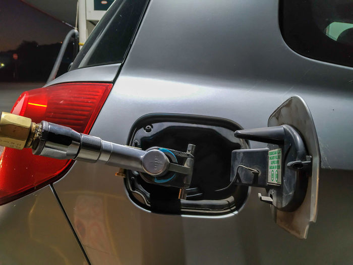 Close-up of car getting refueled
