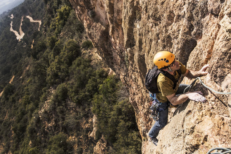 Action Sports Adventure Adventures Brave People Challenge Cliff Climb Climbing Climbing A Mountain Dare To Do It Extreme Sports Headwear Just Do It Multi Pitch Route Nature No Fear One Person Outdoors People Real People RISK Rock - Object Rock Climbing Sports Helmet Strength