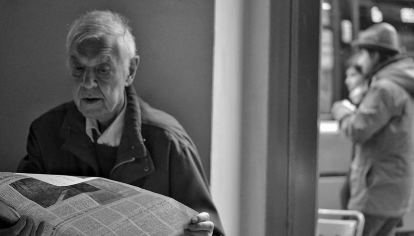 Old&young Selective Focus Black & White Older Man Reading Newspaper Senior Adult Real People One Person Lifestyles Sitting Indoors  Women Close-up Day People