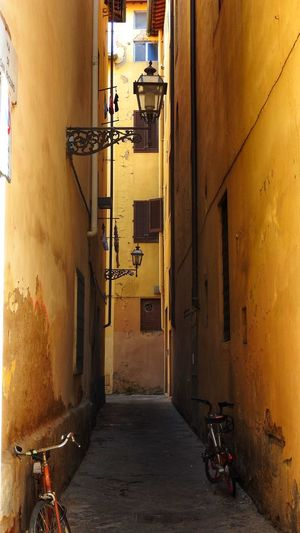 Narrow Alley with lanterns and cycles Alleyway Alley Bicycle Yellow Walls Lanterns Architecture Building Exterior Building Built Structure City Residential District Alley The Way Forward Street Narrow Transportation No People Wall - Building Feature Lighting Equipment Mode Of Transportation Illuminated