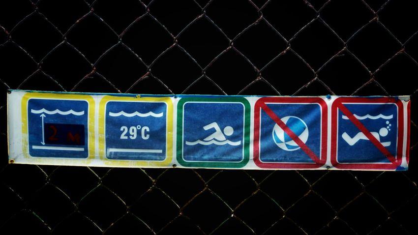 EyeEm Man Swimming Pool Nightphotography Wheelchair Social Issues Industry Fence Warning Sign Warning Do Not Enter Sign Road Warning Sign