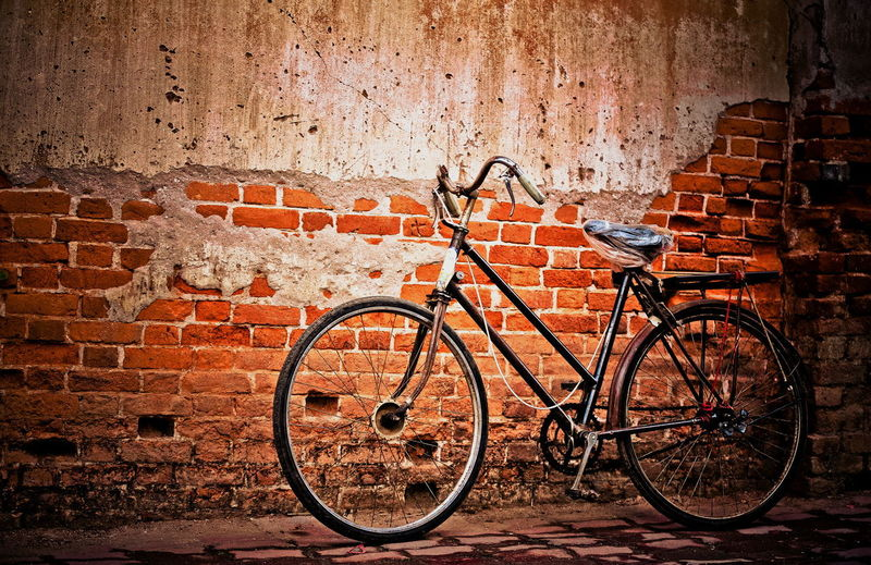 Ancient bicycle parked against the old wall. Thailand Old Wall. Ancient Bicycle Chiang Khan City Architecture Bicycle Brick Brick Wall Building Exterior Built Structure City Day Land Vehicle Leaning Metal Mode Of Transportation No People Outdoors Parking Stationary Stone Wall Transportation Travel Wall Wall - Building Feature Adventures In The City This Is Latin America