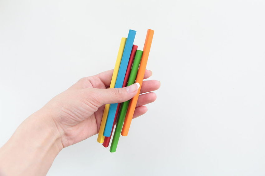 Back To School Chalks Colorful Pencils Different Colors Drawing For School Hand Holding Holding Pencils In A Hand Human Finger Multi Colored Painting Art Part Of Penicls School Things Studio Shot White Background