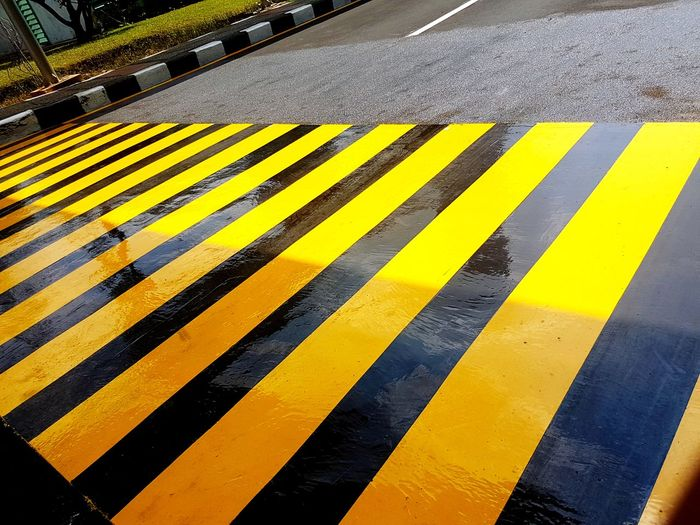 EyeEm Selects LINE Yellow Road Asphalt Communication Street Striped Safety Black Color Text Yellow Line Double Yellow Line Roadways Zebra Crossing Marking Crossing Road Marking