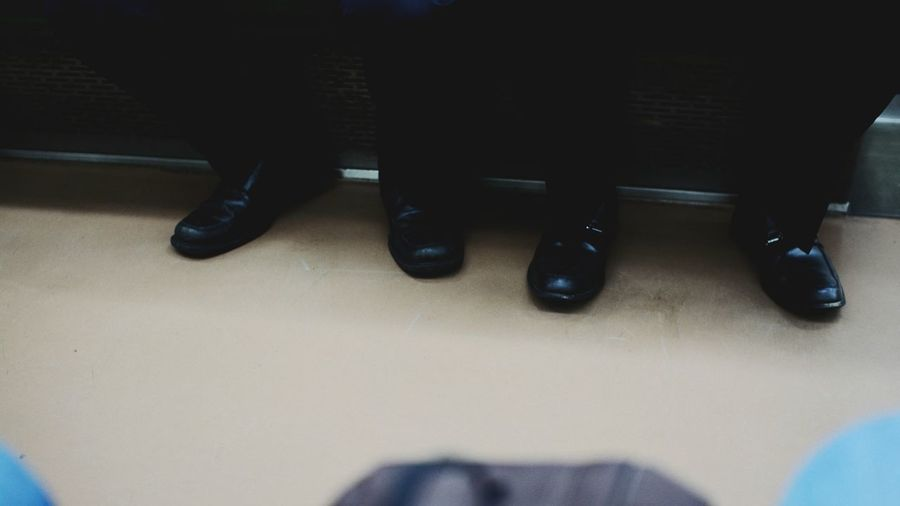 Foot Feet Businessman Low Section Indoors  Shoe Human Body Part Human Leg Adults Only Office People Adult Only Men Men Business Day One Man Only One Person Close-up Train Subway Worker Architecture EyeEmNewHere Art Is Everywhere The Photojournalist - 2017 EyeEm Awards Out Of The Box Let's Go. Together. EyeEm Selects