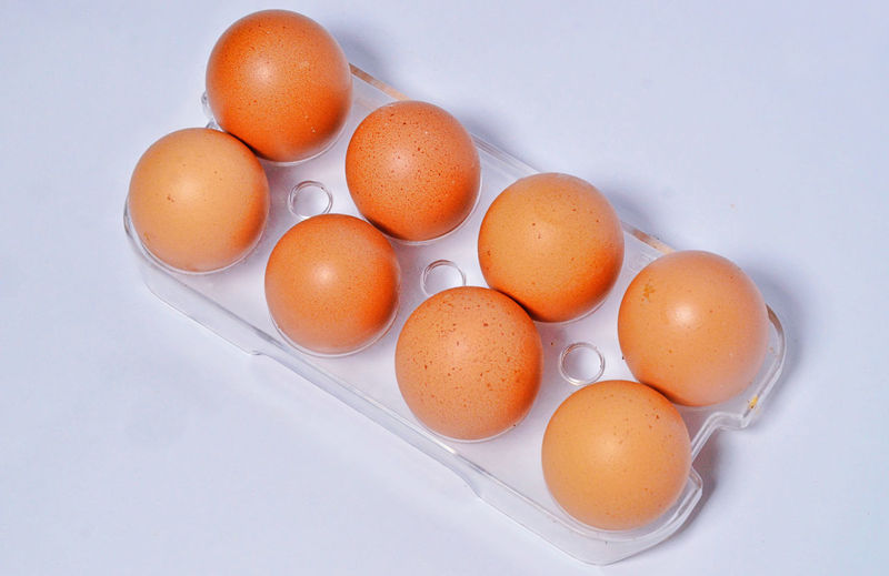 High angle view of eggs in plate