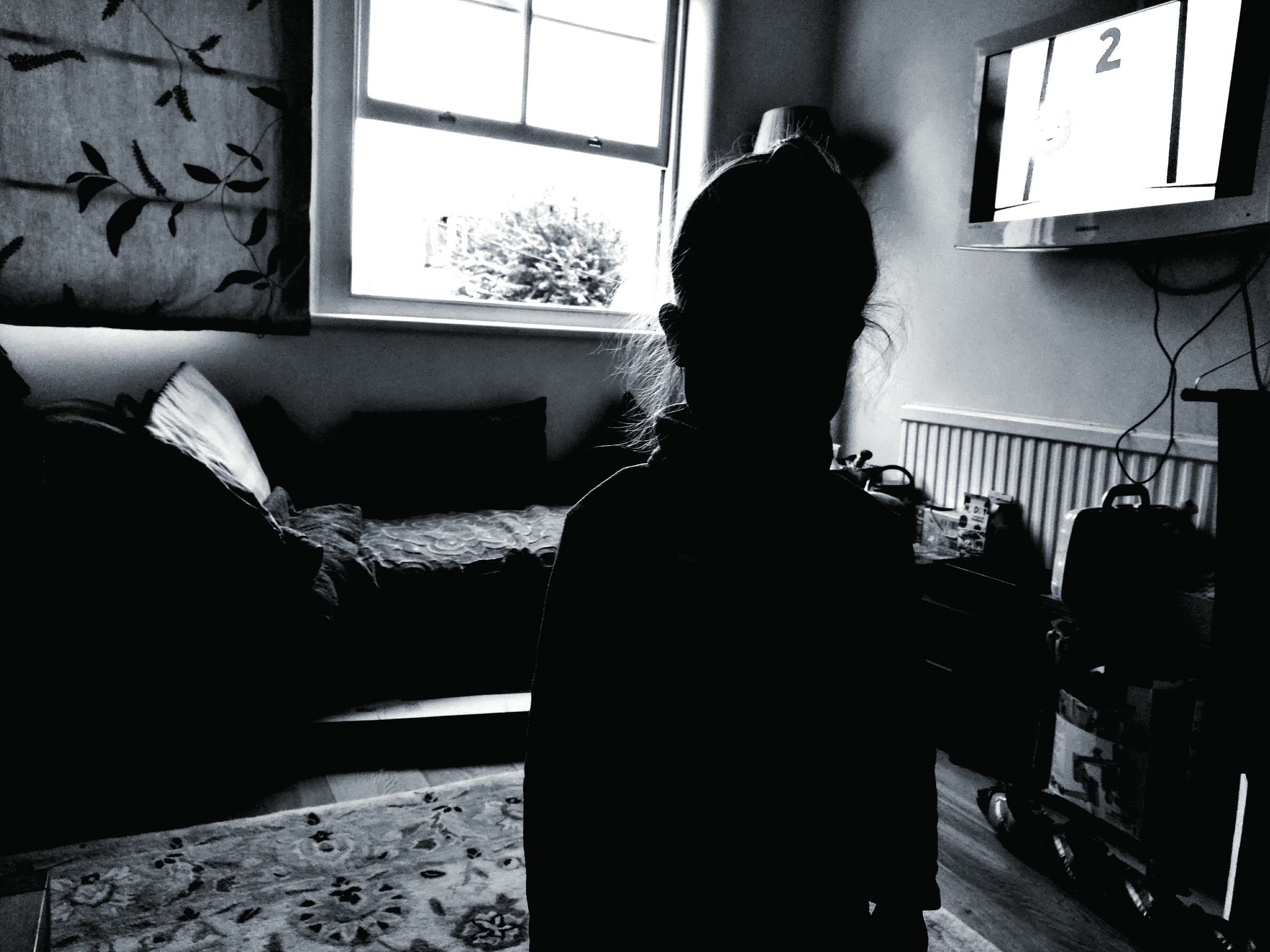 window, indoors, rear view, lifestyles, domestic life, casual clothing, day, loneliness, person, young adult