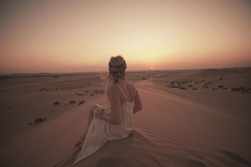 Perfection An Eye For Travel Sand Sand Dune Desert Arid Climate Nature Rear View Sunset One Person Landscape Tranquil Scene Tranquility Beauty In Nature Women Outdoors Sitting
