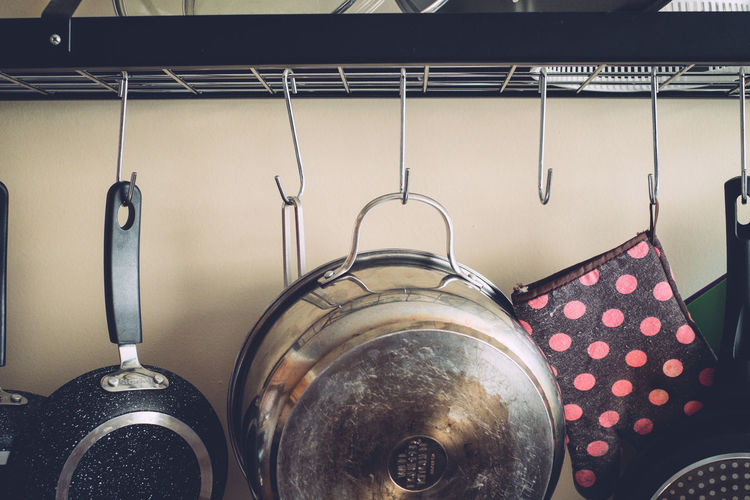 Indoors  Kitchen Household Equipment No People Kitchen Utensil Metal Domestic Room Domestic Kitchen Still Life Home Hanging Close-up Choice Cooking Pan Side By Side