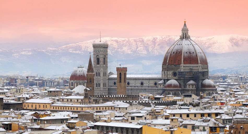 The beautiful Cathedral of Santa Maria del Fiore in Florence after a snowfall, as seen from Piazzale Michelangelo. Florence, Italy. Cityscape Duomo Firenze Florence Cathedral Giotto's Bell Tower Winter Architecture Brunelleschi's Dome Brunelleschisdome Building Exterior Built Structure City Covered In Snow Cupola Day Dome Domestic Animals Florence Giotto Campanile Italy Nature No People Outdoors Sky Snow