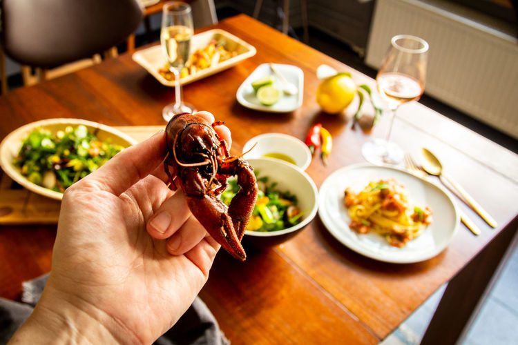 """""""Berlin lobster"""". Eat more invasive species! Human Hand Food And Drink Food Hand Human Body Part Table One Person Freshness Plate Indoors  Holding Ready-to-eat Healthy Eating Unrecognizable Person Focus On Foreground High Angle View Meal Crayfish Crab Red Crayfish Seafood Invasive Species"""