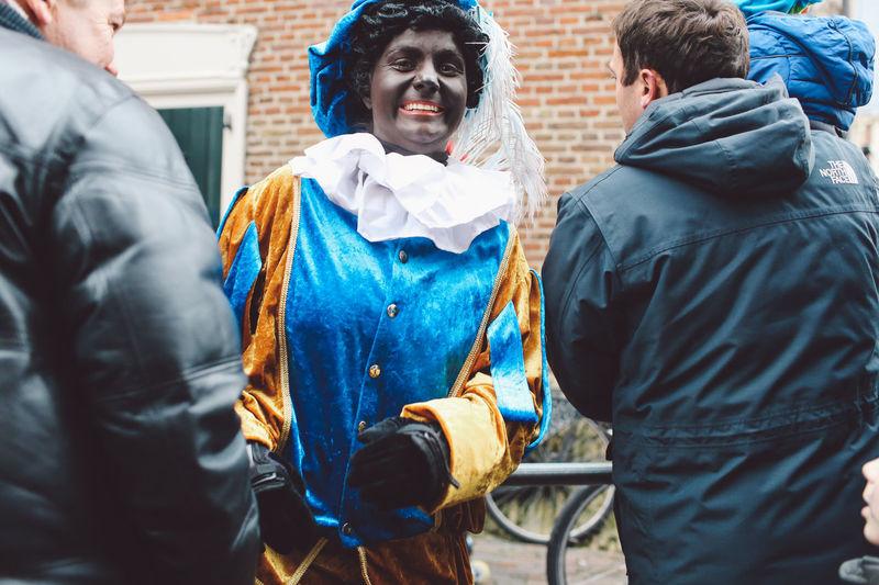 Celebration Day Festival Festival Season Grote Markt Lifestyles Mask - Disguise Men Netherlands Outdoors People Pleading Real People Saint-Nicolas Sint-Nicolaas Sinterklaas Women Zwarte Piet