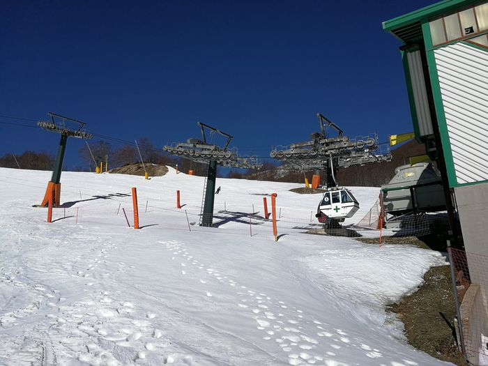Snow Winter Cold Temperature Sky Nature Clear Sky Day White Color Covering Frozen Built Structure Blue Building Exterior Land No People Sunlight Field Beauty In Nature Outdoors Rescue Rescue Cabin Cableway Roccaraso Ski Lifts Ski Runs
