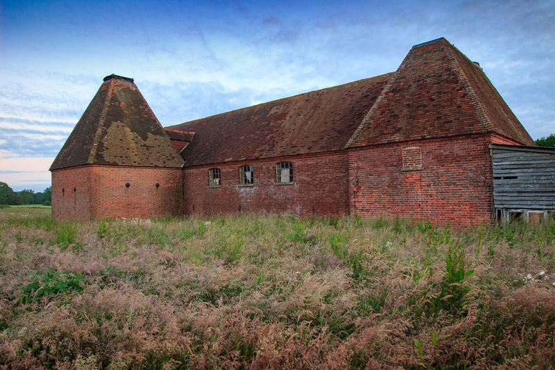 Oast House, Garden Of England, Kent, England. Architecture Sky Built Structure Nature No People Plant Hops Beer Brewing Iconic Buildings Vivid International Getty Images EyeEm Gallery Travel Destinations Tourism Sunrise Countryside Rural Scene History Building Exterior Building Cloud - Sky Land House Grass Day Old Field Abandoned Landscape Outdoors The Past