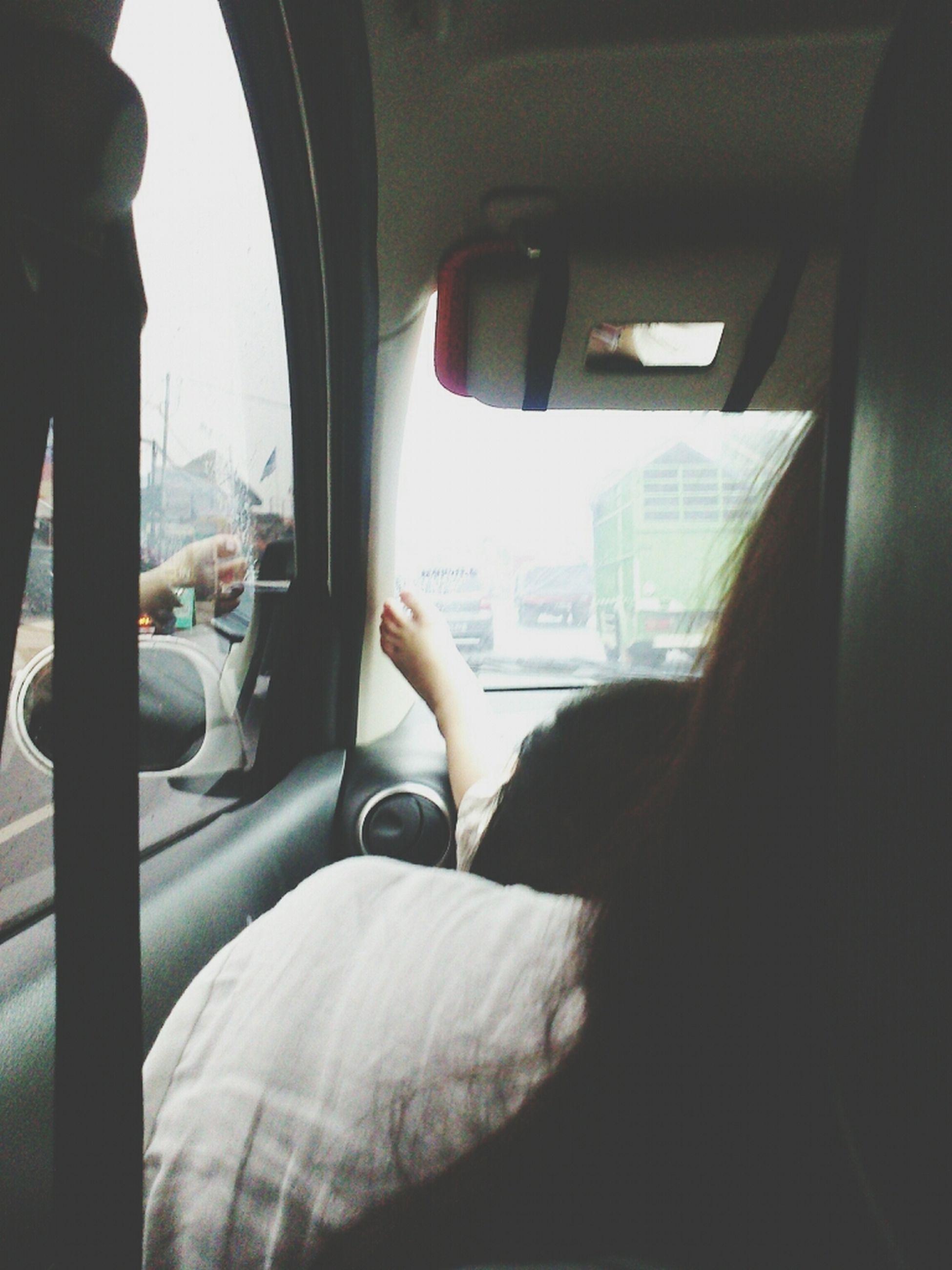 transportation, mode of transport, vehicle interior, land vehicle, car, window, indoors, travel, glass - material, lifestyles, transparent, car interior, public transportation, vehicle seat, leisure activity, men, sitting, journey
