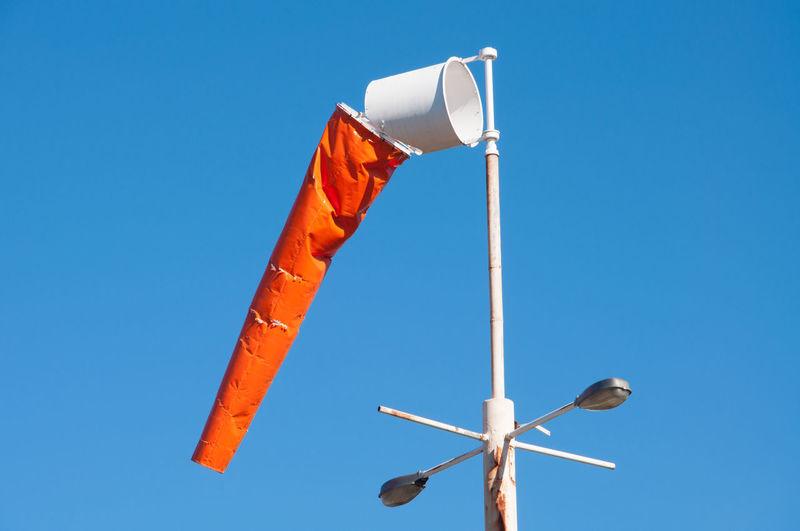 Orange wind sock on a still day