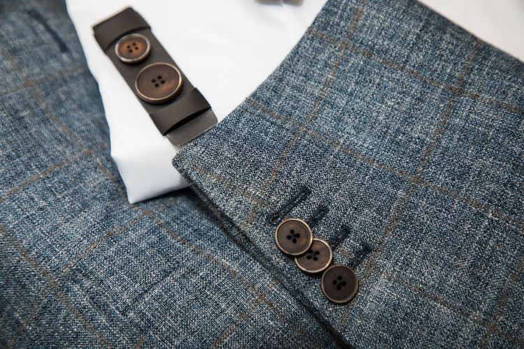 Fashion Suit Tailor Tailored To You Tailoring Art And Craft Button Buttons Close-up Day Detail Equipment Focus On Foreground High Angle View Indoors  Jeans No People Pattern Smart Phone Spool Still Life Table Textile Textile Industry Thread