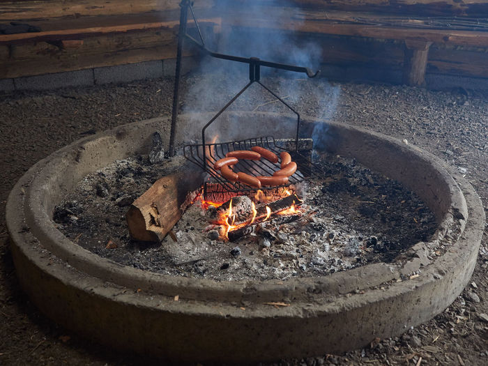 Grilled sausages on fireplace. Bonfire Brick Burning Campfire Fire - Natural Phenomenon Fire Pit Fireplace Firewood Flame Flames Food Glowing Grilled Heat Heat - Temperature No People Orange Color Outdoors Sausage Sausages Smoke Trekking