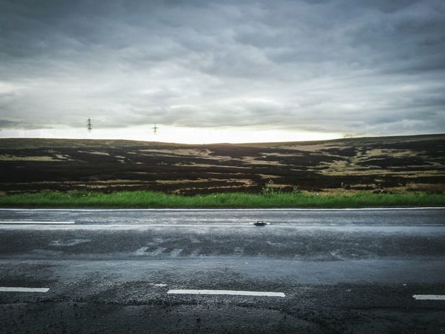 Road Grass Roadside Nature's Diversities Textures And Surfaces Rainy Days Landscape Rain Wet The Great Outdoors - 2016 EyeEm Awards Pavementporn Glare Sunset Glares Seasons Landscape_photography Landscape_Collection Moors Moorland Heather Glow Pylons Clouds Cloudscape Clouds And Sky