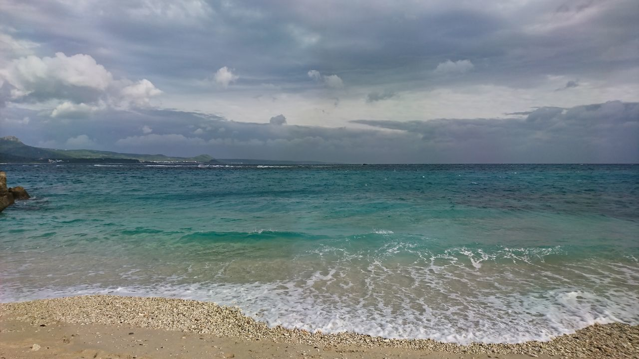 sea, water, sky, cloud - sky, horizon, horizon over water, beach, land, scenics - nature, beauty in nature, tranquility, tranquil scene, nature, motion, wave, day, aquatic sport, non-urban scene, idyllic, outdoors, turquoise colored