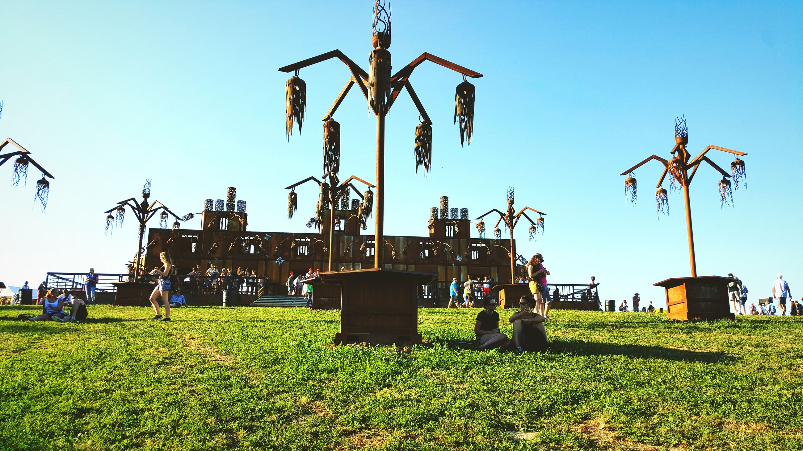 grass, clear sky, development, rural scene, wind power, memories, windmill, blue, traditional windmill, green color, crane - construction machinery, field, growth, alternative energy, renewable energy, monument, day, death, outdoors, tall - high, group of objects