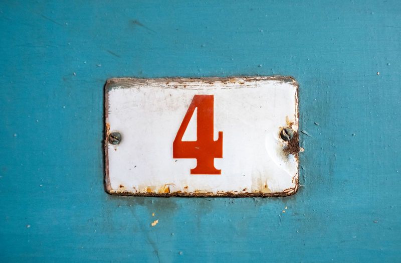 Blue Communication Sign No People White Color Number Close-up Metal Day Rusty Wall - Building Feature Old Weathered Architecture Guidance Shape Door Entrance Information Number 4 Copy Space Red Color Wood - Material The Past Information Sign