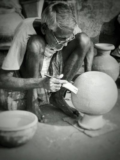 Senior Man Painting Pot