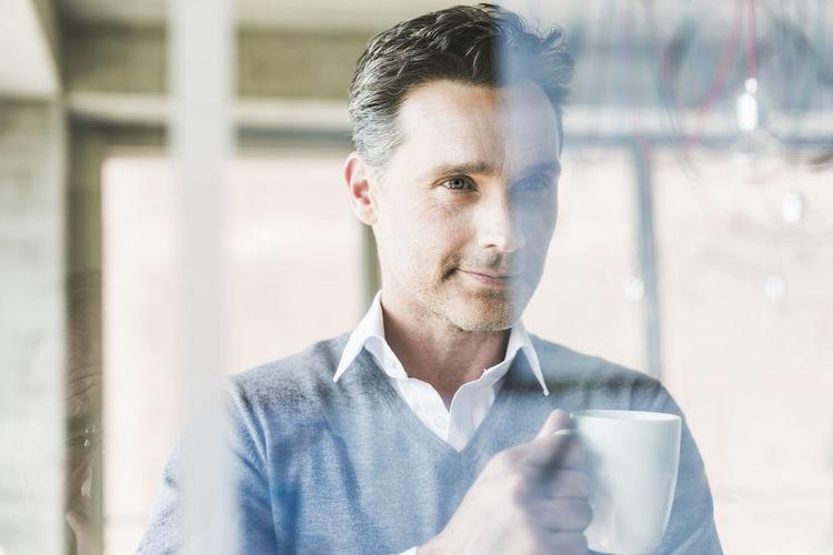 Portrait of man drinking glass