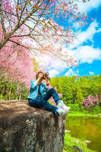 Camera Cherry Blossoms Chiang Mai | Thailand Pink Sakura Taking Photos Thailand Tourist Beauty In Nature Blooming Branch Casual Clothing Flower Happiness Leisure Activity Love Nature Outdoors People Sitting Sky Smiling Travel Destinations Tree Young Women