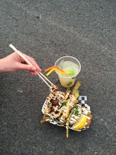 Fried. Asphalt Chopsticks Day Food And Drink Fried Food Fried Okra Hand Holding Lifestyles Okra Outdoors Outside Street Food Street Food Worldwide Take Out View From Above