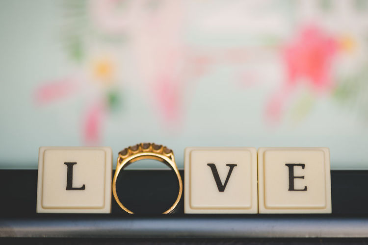 Text Letter Communication Capital Letter Still Life Western Script Close-up No People Alphabet Indoors  Toy Block Focus On Foreground Selective Focus Table Paper Block Love Wood - Material Gold Colored Positive Emotion Ring Love