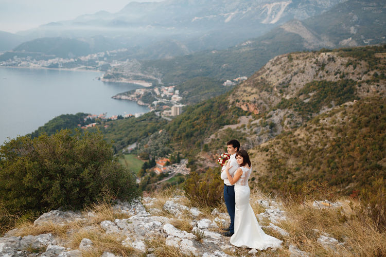 Side view of a young couple standing on mountain