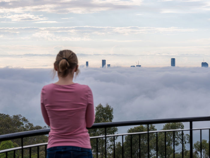 fog One Person Cloud - Sky Sky Real People Rear View Lifestyles Railing Standing Leisure Activity Women Three Quarter Length Casual Clothing Nature Beauty In Nature Scenics - Nature Adult Looking At View Outdoors Waist Up Hairstyle