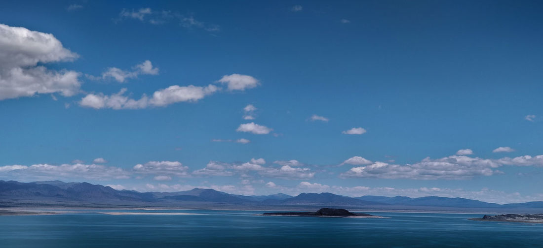 """I think """"wildness"""" is an essential quality. Mono Lake has it in abundance even though it is right next to a highway. Beauty In Nature Blue Lake, Sky, Clouds, Mountains, Desert, Nature, Landscape Mono Lake No People Non-urban Scene Outdoors Remote Scenics - Nature Water"""