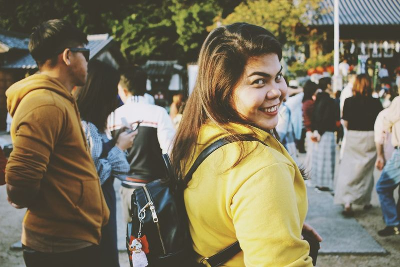 Beautiful millennial. Portraits Of EyeEm portrait of a friend Yellow Clothing Portrait Photography Portrait Of A Woman Women Streetphotography Japan Japan Photography Photography Traditional Festival Real People Incidental People Lifestyles Happiness Smiling Women Adult Leisure Activity Waist Up Young Adult Casual Clothing Group Of People People Emotion Clothing Focus On Foreground Togetherness Standing