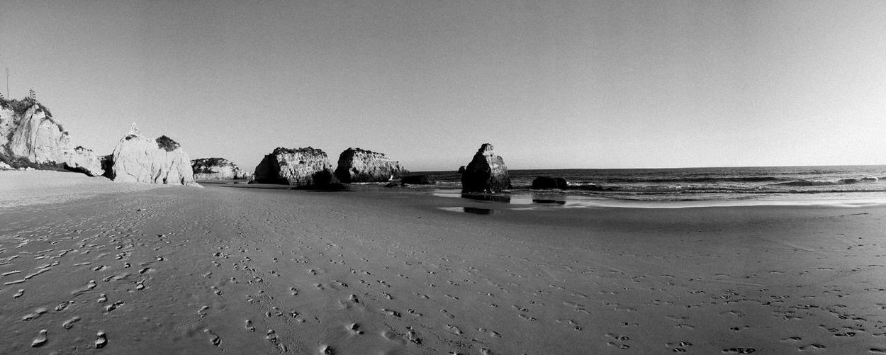 footprints Beach Beauty In Nature Blackandwhite Photography Calm Clear Sky Copy Space Horizon Over Water Nature Non-urban Scene Ocean Ocean View Outdoors Portugal Remote Rock Formation Sand Scenics Sea Shore Surface Level Tones Tranquil Scene Tranquility Vacations Water
