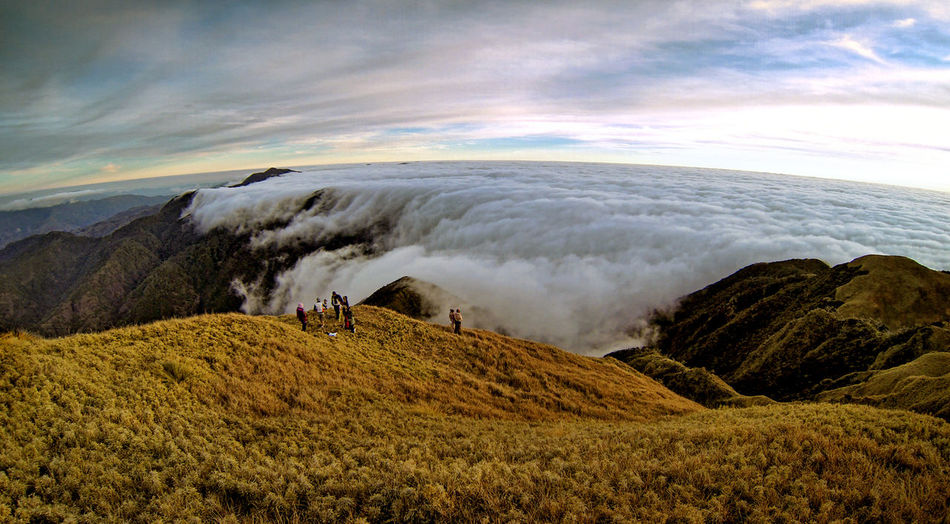 Scenic View Of Mountains Covered In Clouds