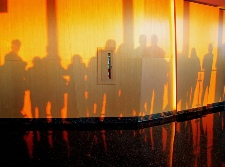 Inside WTC One observation deck during sunset. Gold Gold Sunset Silhouettes Sunset Silhouettes Sunset Shadows Sunset Silhouette WTC Wall Architecture Golden Hour Indoors  Indoors  Men People People Shadow People Silhouettes Photographing Reflection Shadows Shadows On The Floor Shadows On The Wall Silhouette Sunset World Trade Center