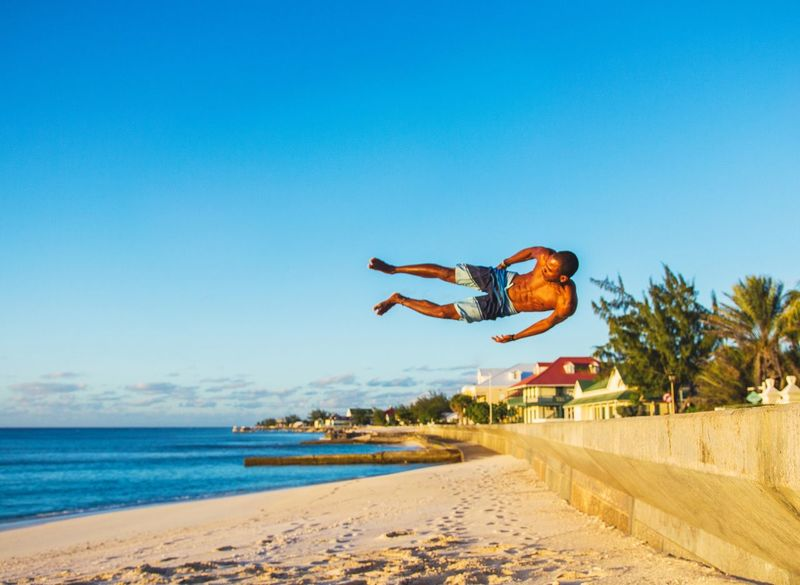 🤸life tends to throw us around a bit, the landings are what matters most🤾~ Beach Mid-air Jumping Sand Sea Summer Beauty In Nature Grandturk Turksandcaicos Adventure Paradise Tropical Climate Flips  Acrobatics  Freerunning Parkour Stunts