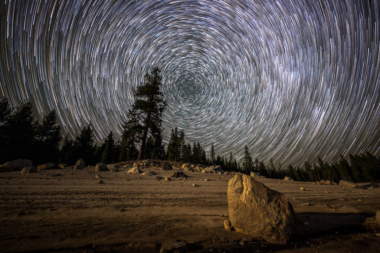 Will us humans be around | I decided to post this star trails that I did at Thomas Edison Lake. JMT DAY 11 - STAR TRAILS AT THOMAS EDISON LAKE Star trails at Thomas Edison Lake Once done capturing the Milky Way over Thomas Edison Lake, I replanted my camera and pointed it at Polaris. By this time, the moon was hanging quite high, showering Earth with bright light. At least, this part of the planet anyway. Above the tall pines, the only thing my eyes only see was the heavenly body strewn with countless stars. While doing the star trails, I sat in the beach, letting myself get lost in solitude. But then the wind often snapped me out of it. Slightly trembling, it often surprised me that not a single soul was seen nor around. Just me, stars and the winds that never seemed to calm down. Polaris, aka North Star, is 433 light years away. That's really far, and yet, it is extremely bright. What many people are not aware of is that it is a multiple star, three of them to be exact, and that it will no longer be called North Star in about 12,000 years. The fact that Earth wobbles causes its axis to move slightly. Vega in the constellation Lyra is expected to become our next North Star. But then, will us humans be around to witness that? Thomas Edison Lake, Sierra National Forest, CA Night Star - Space Astronomy Scenics - Nature Long Exposure Nature Sky Star Trail Beauty In Nature Tranquility Tranquil Scene No People Constellation Galaxy Landscape Motion Polaris North Star Thomas Edison Lake, CA Sierra Nevada Eastern Sierra Forest Trees Beach Vermilion Valley Resort