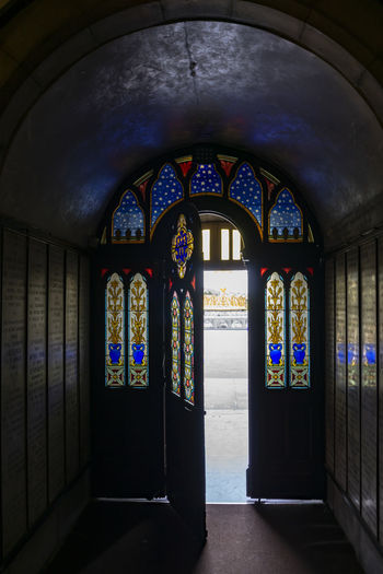 the door is open.... Arch Architecture Indoors  Building Built Structure Religion Place Of Worship Belief Spirituality Window No People Day Stained Glass Art And Craft Glass Flooring Multi Colored Creativity Architectural Column Ornate Floral Pattern Door Lourdes darkness and light Exceptional Photographs Open Door EyeEm Gallery