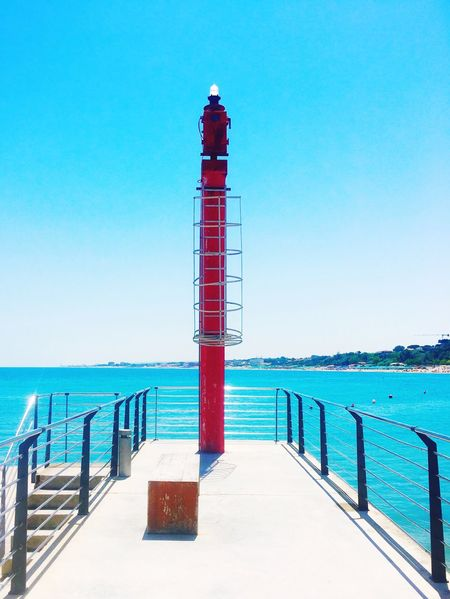 Sea Safety Lighthouse Horizon Over Water Water Clear Sky Protection Blue Tranquil Scene Tranquility Sky The Week On EyeEm